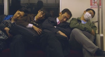 men-sleeping-on-train